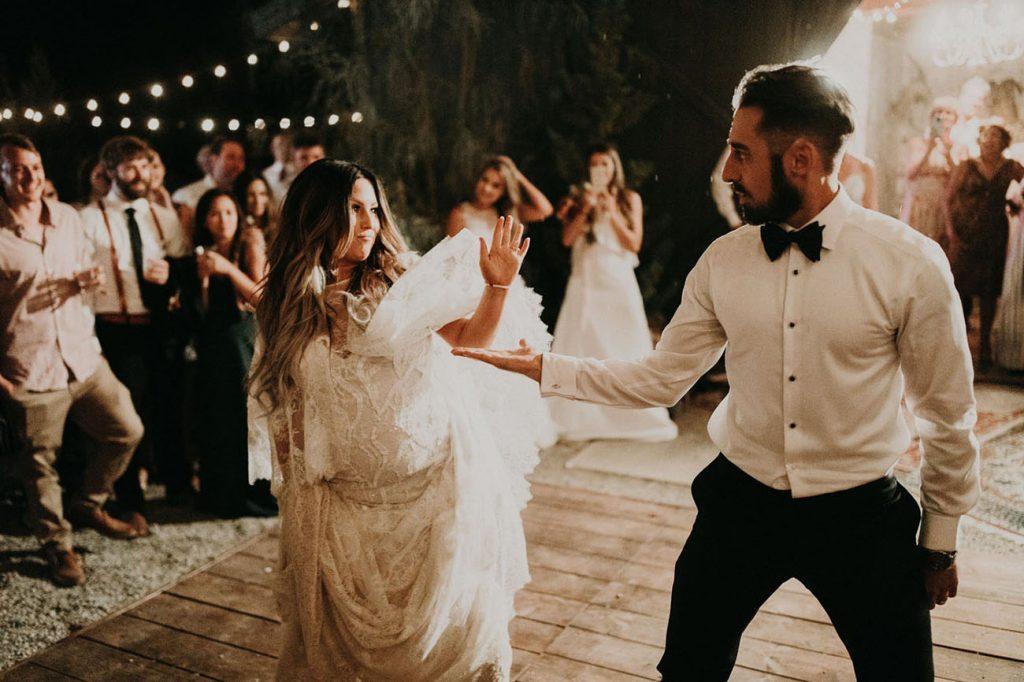 Discover Tiffany and Joey's wedding, who got married in the mountains of South California, in an under a tipi in an open landscape in a boho style wedding.